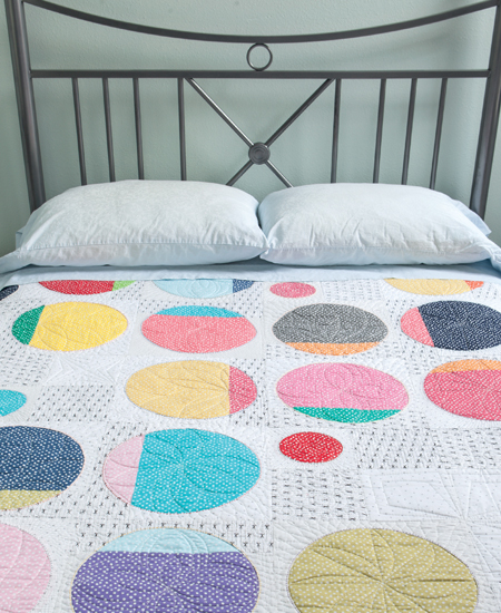 Circle Shuffle Quilt from A Modern Twist by Natalie Barnes (photo by Brent Kane, Martingale)
